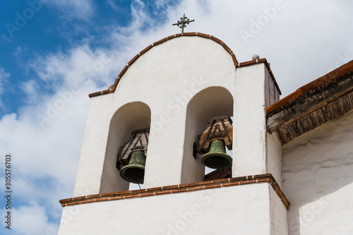 White Spanish mission church bell tower with two bells in Santa Barbara, Califor Wallpaper Mural