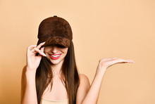 Sexy Beautiful Brunette Woman In A Brown Suede Baseball Cap