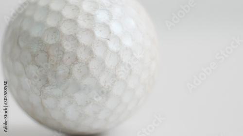 Valokuva  Old golf ball on white tone.