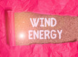 canvas print picture - Handwriting text Wind Energy. Conceptual photo the process by which wind is used to generate electricity Cardboard which is torn in the middle placed above a wooden classic table