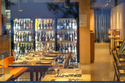View of a European cafe, restaurant in the evening through stained glass фототапет