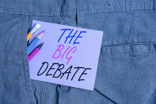 Writing Note Showing The Big Debate. Business Concept For Lecture Speech Congress Presentation Arguments Differences Writing Equipment And Purple Note Paper Inside Pocket Of Trousers