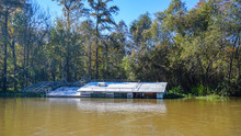 A Sunken House Boat Lays Victi...