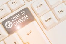 Writing Note Showing Adapt To Changes. Business Concept For Embrace New Opportunities Growth Adaptation Progress White Pc Keyboard With Note Paper Above The White Background