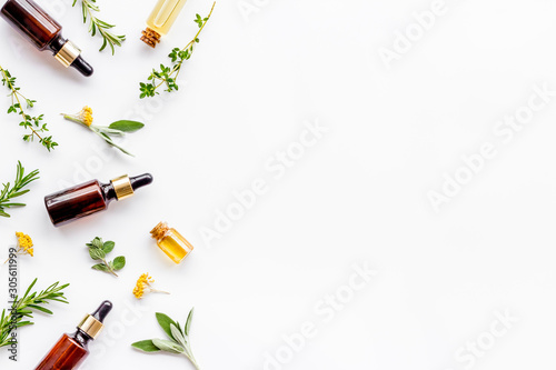 Fototapeta Essential oils and fresh herbs on white background top view pattern frame copy spacee obraz