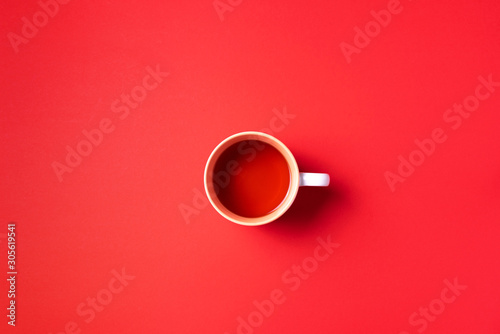 Cup of tea on red background Wallpaper Mural
