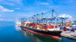 canvas print picture Container cargo ship at industrial port in import export business logistic and transportation of international by container cargo ship in the open sea.