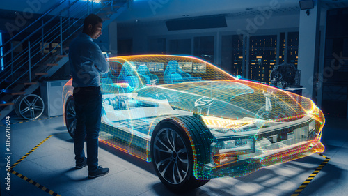 In Automotive Innovation Facility Automobile Design Engineer Working on 3D Holographic Model Projection of Electric Car Wallpaper Mural