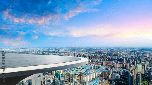 Foto op Plexiglas Purper Empty floor and city skyline with beautiful clouds scenery in Shanghai at sunset.high angle view.