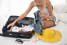 Woman Preparing Clothes For Va...