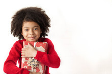 Festive Christmas Concept. Happy Adorable African American Child Girl With Christmas Gift In Hands Isolated On White Background