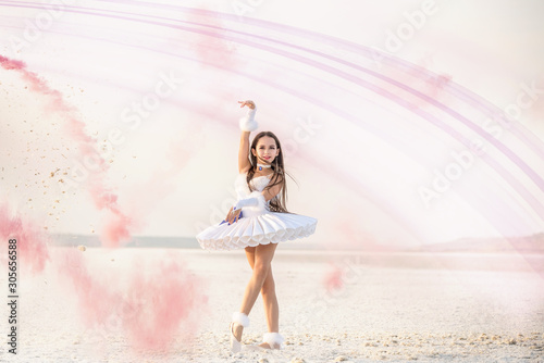 Tender young ballerina dancer in a snow-white tutu dress and white pointe shoes in pink smoke Tapéta, Fotótapéta