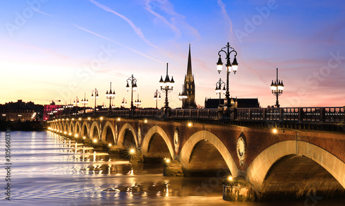 View of the Pont de pierre  with sunset sky scene which  The Pont de pierre crossing Garonne river,