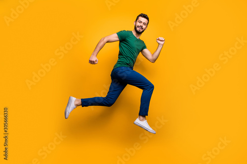 Fotomural Full size photo of cheerful guy jump run fast for discounts wear modern clothing