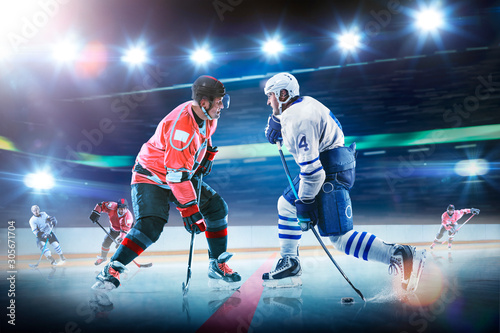 Photo Professional hockey players in action on grand arena