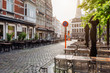 canvas print picture - Old square with tables of cafe in Ghent (Gent), Belgium. Architecture and landmark of Ghent. Cozy cityscape of Ghent.