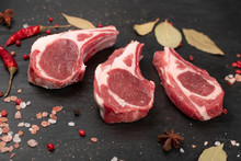 Raw Lamb Chops, Mutton Cuts Or Sheep Ribs On Black