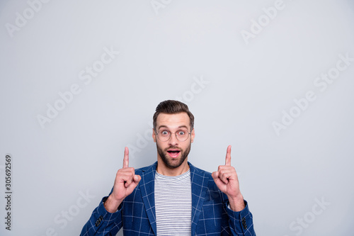 Obraz Photo of cheerful fun positive creative man with stubble pointing up at empty space for you to see new information isolated over grey color background - fototapety do salonu