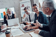 Successful business team analyzing strategy while working in the modern office