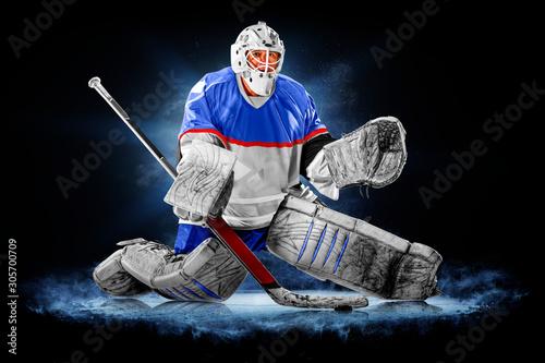 Fotomural Professional ice hockey goalkeeper or goalie or goaltender isolated on black bac