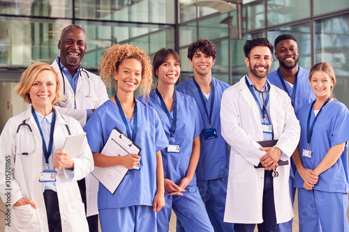 Portrait Of Smiling Medical Team Standing In Modern Hospital Building Wallpaper Mural
