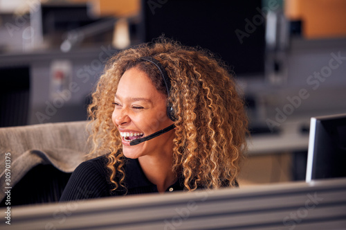 Fényképezés Laughing Businesswoman Wearing Telephone Headset Talking To Caller In Customer S