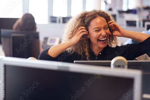 Laughing Businesswoman Wearing Telephone Headset Talking To Caller In Customer S Fototapeta