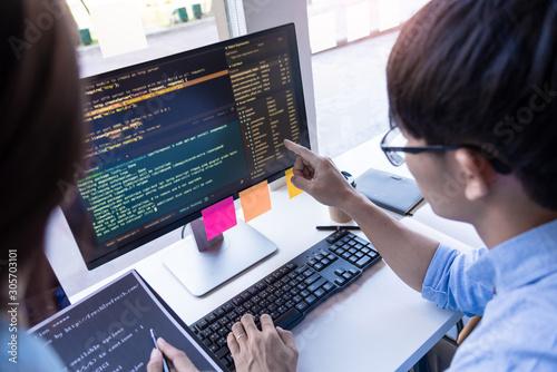 Fotomural Pensive programmer working on on desktop pc programming code technologies or web