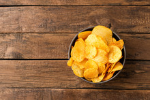 Tasty Potato Chips In Bowl On ...