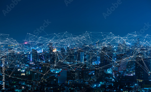 Modern city with wireless network connection and city scape concept.Wireless network and Connection technology concept with city background at night. - 305708522