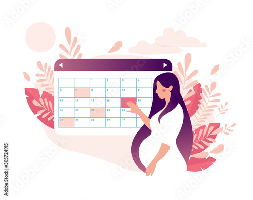 Photo A woman is planning a medical appointment with a doctor on a calendar