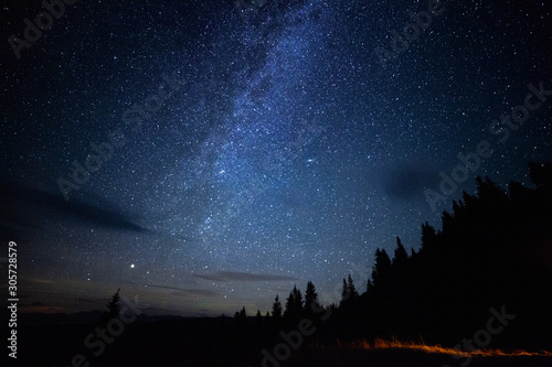Milky way long exposure astrophotography night sky with stars outdoor scene in mountains forrest Canvas-taulu