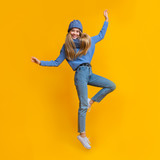 Young winter woman showing dancing moves in the air