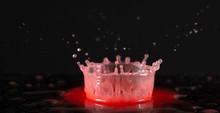 Red Liquid Ink Splash On Black...