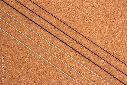 Classical guitar strings on balsa wood texture background Wallpaper Mural