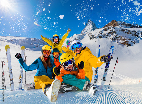 Happy family enjoying winter vacations in mountains Wallpaper Mural