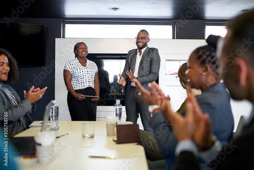 Fototapeta Attractive black businessman being encouraged by diverse multi-e obraz