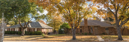 Panoramic single story bungalow houses in suburbs of Dallas with bright fall fol Canvas Print