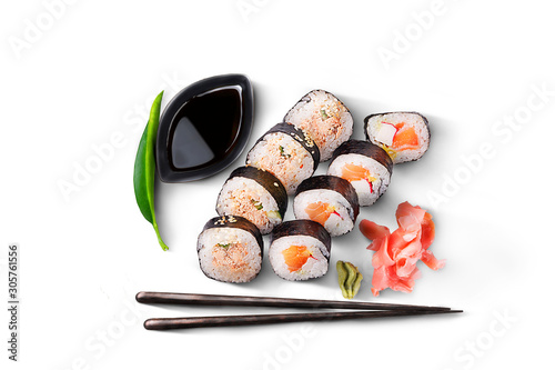 Fototapeta A maki sushi set. 8 pieces with salmon, wasabi, ginger, soy sauce and chopsticks. A packshot photo, isolated on white. obraz