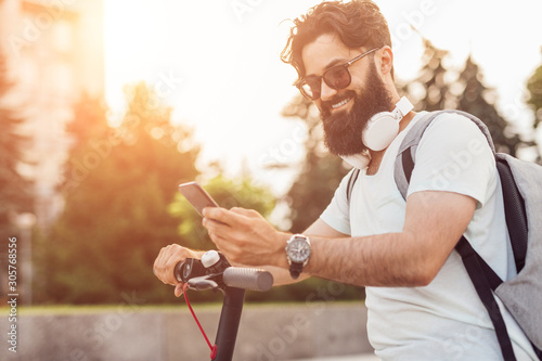 Cheerful hipster using smartphone during ride Fototapet