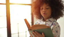 African Girl Reading Text Book