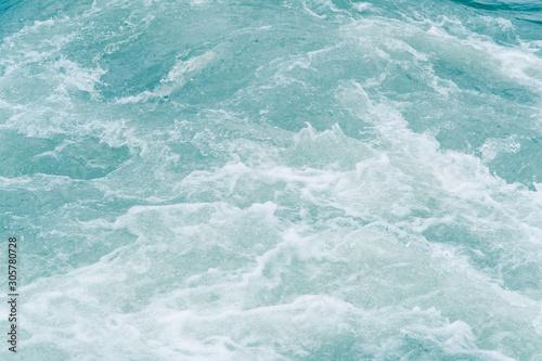 Cuadros en Lienzo  Blue ocean waves, tide. Swift current of river
