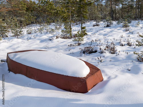 Fototapety, obrazy: winter landscape with a snow-covered boat on the shore of a lake