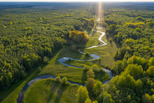 Forest In Summer Colors. Green Deciduous Trees And Winding Blue River In Sunset. Mulgi Meadow, Estonia, Europe