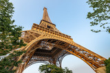 Fototapeta Wieża Eiffla - Eiffel tower against blue sky. Wide angle shot from below. Paris, France.