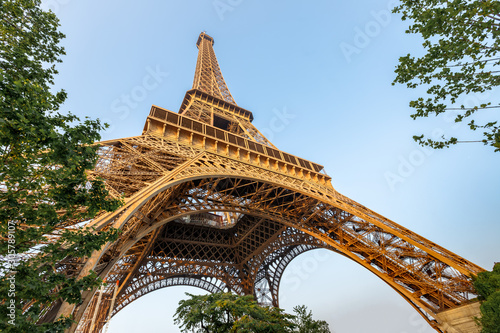 Eiffel tower against blue sky. Wide angle shot from below. Paris, France. - 305789107