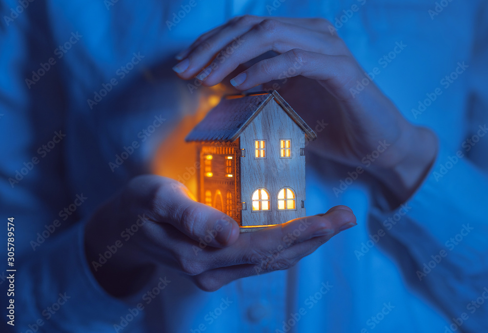 Fototapeta concept technology protection of the house from the cold. house in caring female hands