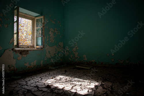 Interior of a dirty abandoned  room with dry cracked mud Canvas Print