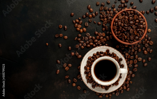 Wall Murals Cafe Cup of tasty coffee and beans on a stone background. Top view with copy space for your text.