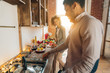 Happy african-american couple cooking dinner in kitchen